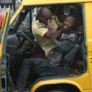 Road traffic officer fighting with a commercial bus driver
